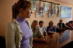 Olga Nastina, an attorney, meets with Fedir Kucher, 72, Tamara Sovenko, and Ljudmila Kashpirovska  about about their legal issues at the village community center, Bila Tserkva, Ukraine, June 14, 2011. More than half of the worldÕs population, four billion people, live outside the rule of law, with no effective title to property, access to courts or redress for official abuse. The Open Society Justice Initiative is involved in building capacity and developing pilot programs through the use of community-based advocates and paralegals in Sierra Leone, Ukraine and Indonesia. The pilot programs, which combine education with grassroots tools to provide concrete solutions to instances of injustice, help give poor people some measure of control over their lives.