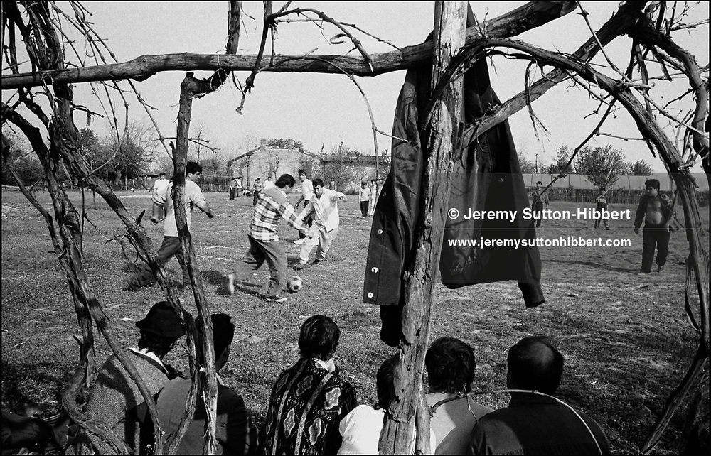 THE ANNUAL FOOTBALL GAME. ROMANIAN ORTHODOX EASTER CELEBRATIONS. SINTESTI, ROMANIA, EASTER 1995..©JEREMY SUTTON-HIBBERT 2000..TEL./FAX. +44-141-649-2912..TEL. +44-7831-138817.