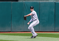 April 18, 2018 - Oakland, CA, U.S. - OAKLAND, CA - APRIL 18: Chicago White Sox center fielder Adam Engel (15) sets to rifle the ball to the infield after catching a fly ball during the game between the Chicago White Sox verses the Oakland Athletics on Wednesday, April 18, 2018 at O.co Stadium in Oakland, CA (Photo by Douglas Stringer/Icon Sportswire) (Credit Image: © Douglas Stringer/Icon SMI via ZUMA Press)