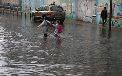 November 10, 2018 - Gaza, gaza strip, Palestine - Palestinian school children walk in a flooded street during heavy rain in Gaza City on November 10, 2018. (Credit Image: © Majdi Fathi/NurPhoto via ZUMA Press)