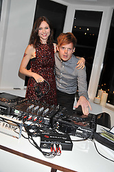 SOPHIE ELLIS-BEXTOR and RICHARD JONES at a party to celebrate the opening of the new Nicole Farhi global flagship store at 25 Conduit Street, London W1 on 19th September 2011.