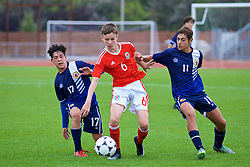 NEWPORT, WALES - Sunday, September 24, 2017: Wales' Owen Hesketh with Gibraltar's Julian Del Rio [L] and Issak Vinet [R] during an Under-16 International friendly match between Wales and Gibraltar at the Newport Stadium. (Pic by David Rawcliffe/Propaganda)