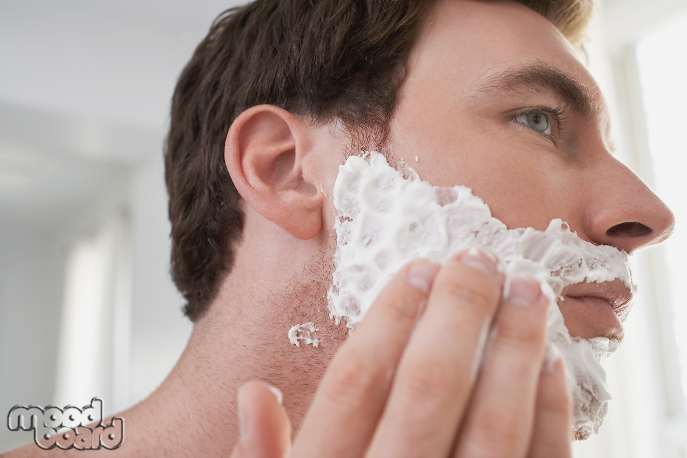 Man applying shaving cream close-up