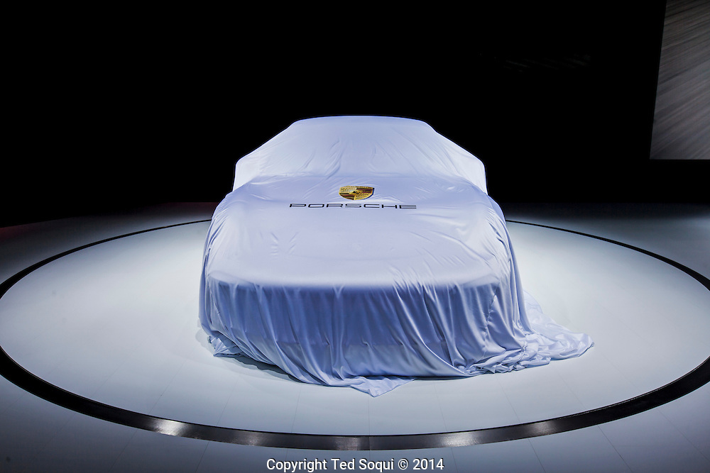 The 2014 Los Angeles Auto Show at the Los Angeles Convention Center.<br />  A new model Porsche under a drop cloth at the auto show.