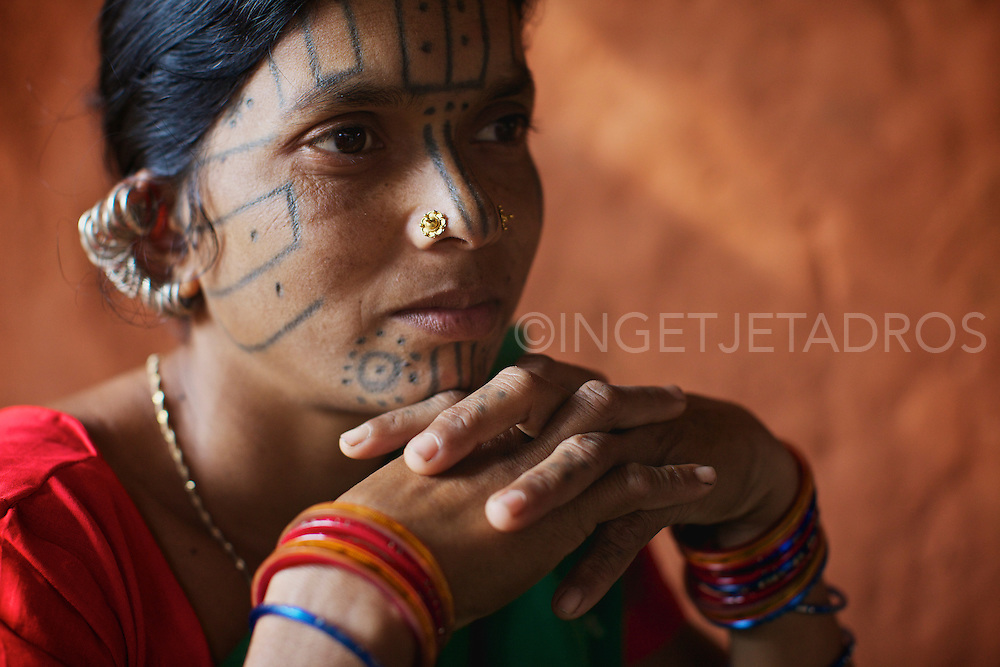 The women from the Desia Kondh tribe are readily identifiable by their geometric facial tattoos that on close observation bear striking similarity to tiger's whiskers. These identifying marks ensure they will recognize each other in the spirit world.<br />