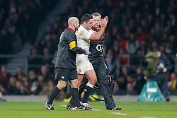 England Inside Centre Billy Twelvetrees leaves the pitch after cutting his eye whilst tackling Australia replacement Quade Cooper - Photo mandatory by-line: Rogan Thomson/JMP - 07966 386802 - 29/11/2014 - SPORT - RUGBY UNION - London, England - Twickenham Stadium - England v Australia - QBE Autumn Internationals.