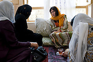 Due to a constant stream of visitors, already during breakfast MP Ms. Fawzia Koofi receives female guests and listens to their concerns and grievences. Faizabad, Badakshan, Afghanistan, 2012