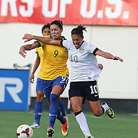 Brazil midfielder Gabi Zanotti (9) and U.S. midfielder Carli Lloyd (10) fight for the ball during a women's soccer International friendly match between Brazil and the United States National Team, at the Florida Citrus Bowl  on Sunday, November 10, 2013 in Orlando, Florida. The U.S won the game by a score of 4-1.  (AP Photo/Alex Menendez)