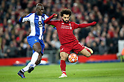 Liverpool forward Mohamed Salah (11) and FC Porto midfielder Danilo Pereira (22) challenge for the ball during the Champions League Quarter-Final Leg 1 of 2 match between Liverpool and FC Porto at Anfield, Liverpool, England on 9 April 2019.