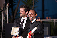 Shahab Hosseini and Asghar Farhadi with their awards for the film Forushande (The Salesman) at the Palm D'Or Winners photocall at the 69th Cannes Film Festival Sunday 22nd May 2016, Cannes, France. Photography: Doreen Kennedy