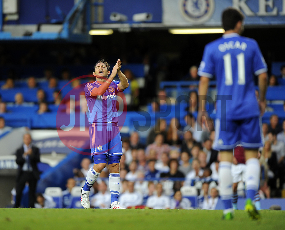 """Chelsea Manager, Jose Mourinho (left) and Chelsea's Frank Lampard (centre) applaud Chelsea's Oscar's (right) effort  - Photo mandatory by-line: Joe Meredith/JMP - Tel: Mobile: 07966 386802 21/08/2013 - SPORT - FOOTBALL - Stamford Bridge - London - Chelsea V Aston Villa - Barclays Premier League - EDITORIAL USE ONLY. No use with unauthorised audio, video, data, fixture lists, club/league logos or """"live"""" services. Online in-match use limited to 45 images, no video emulation. No use in betting, games or single club/league/player publications"""