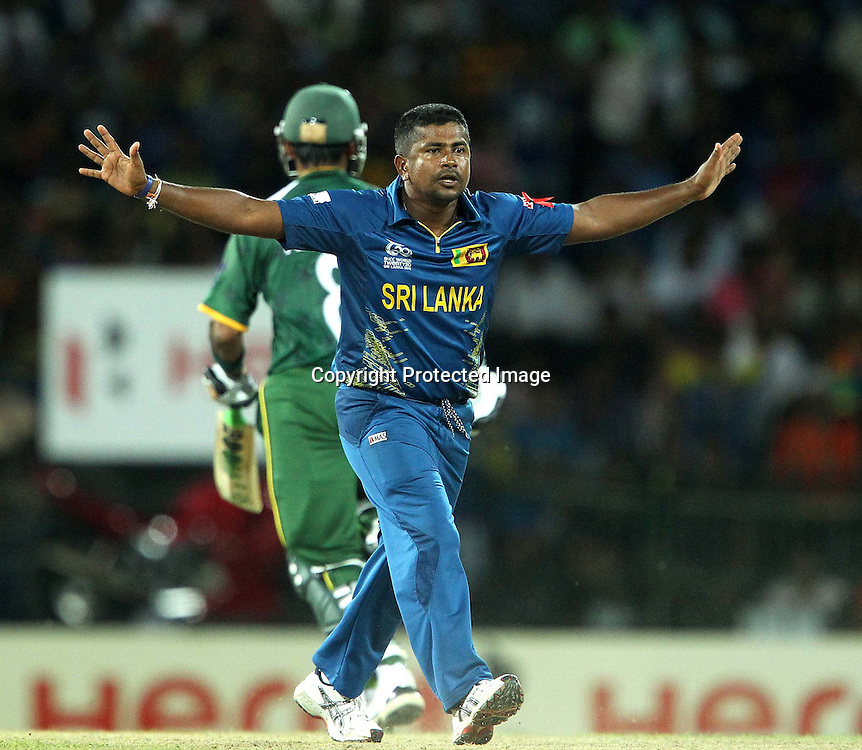 Rangana Herath appeals for the wicket of Nasir Jamshed during the ICC World Twenty20 semi final match between Sri Lanka and Pakistan held at the Premadasa Stadium in Colombo, Sri Lanka on the 4th October 2012<br /> <br /> Photo by Ron Gaunt/SPORTZPICS