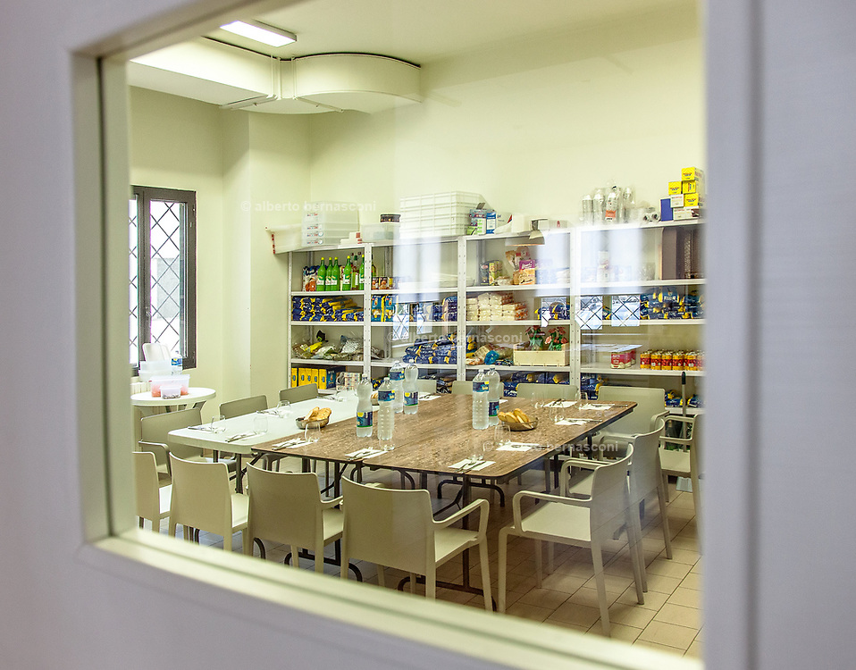 Milan, Bollate, InGalera Restaurant: the store room and the table set for the staff lunch.