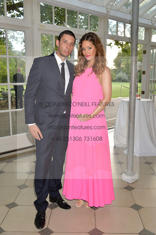 Musician EXAMPLE (Elliot Gleave) and his wife ERIN GLEAVE at 'A Night of Champions' an evening to raise funds for the Mo Farah Foundation held at The Hurlingham Club, London on 28th August 2014.