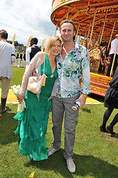 PENNY SMITH and VINCE LEIGH at the 2012 Veuve Clicquot Gold Cup Final at Cowdray Park, Midhurst, West Sussex on 15th July 2012.