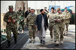 Imam Asim Hafiz with British officers on his way to meet Afghan Army Troops on a visit to  Camp Qargha in Kabul, 19th January 2014 . Picture by Andrew Parsons / Parsons Media Ltd