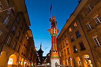 Zahringen Fountain (Zahringerbrunnen) with the Clock Tower (Zytglogge) in the background, at night, Bern, Canton Bern, Switzerland