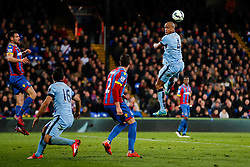 Vincent Kompany of Manchester City heads the ball - Photo mandatory by-line: Rogan Thomson/JMP - 07966 386802 - 06/04/2015 - SPORT - FOOTBALL - London, England - Selhurst Park - Crystal Palace v Manchester City - Barclays Premier League.