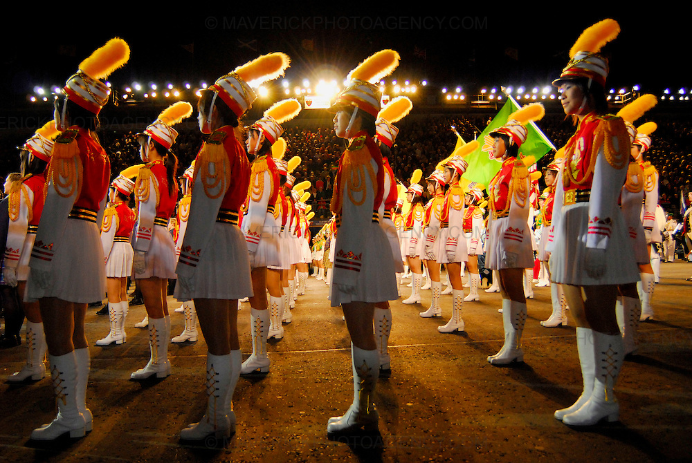 Dancers, musicians,stunt men and women put on a colourful show at the dress rehersal of this years 58th Edinburgh Military Tattoo at Edinburgh Castle Esplanade. The event is the largest gathering of military musicians in the UK with participants from as far afield as Africa, America and Asia.  This years showpiece military extravaganza is set to pay tribute to the Diamond Wedding Anniverary of HM The Queen and HRH Prince Phillip. Pictured The Taipei First Girls' Senior High School Honour Guard and Drum Corps.