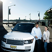 May 3, 2017 - New York, NY : Kevin, left, and Tiffany Chiles pose for a portrait in front of their SUV -- which sometimes functions as their mobile workstation -- on Little 12th Street in Chelsea on Wednesday afternoon. The two are the founders and publishers of Don Diva magazine.  CREDIT: Karsten Moran for The New York Times
