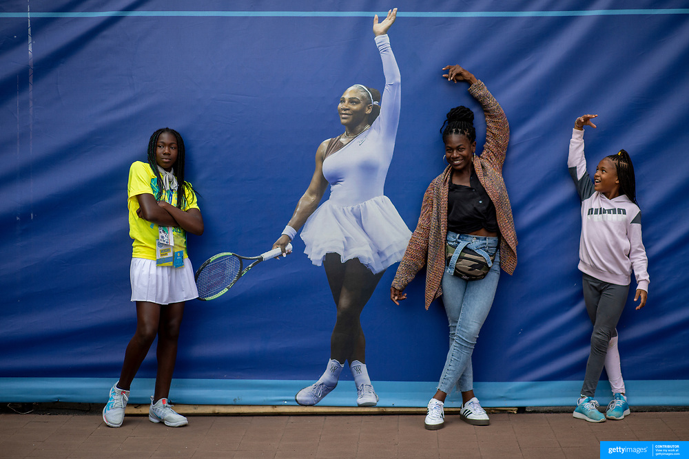 2019 US Open Tennis Tournament- Day Two. Fans young and old pose with a life size photograph of Serena Williams.  Life size photographs of the stars of tennis line a fence between Arthur Ashe Stadium and Louis Armstrong Stadium at the 2019 US Open Tennis Tournament at the USTA Billie Jean King National Tennis Center on August 27th, 2019 in Flushing, Queens, New York City.  (Photo by Tim Clayton/Corbis via Getty Images)