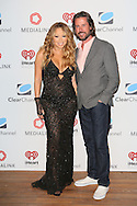 CAP D'ANTIBES, FRANCE - JUNE 17:  Mariah Carey and Jeff Howard, Clear Channel attend Clear Channel Media And Entertainment And MediaLink Dinner at Hotel du Cap-Eden-Roc on June 17, 2014 in Cap d'Antibes, France.  (Photo by Tony Barson/Getty Images for Clear Channel)