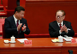epa06272541 Chinese President Xi Jinping (L) and former President Jiang Zemin (R) clap during the opening ceremony of the 19th National Congress of the Communist Party of China (CPC) at the Great Hall of the People (GHOP) in Beijing, China, 18 October 2017. China holds the 19th Congress of the Communist Party of China, the country's most important political event where the party's leadership is chosen and plans are made for the next five years. Xi Jinping is expected to remain as the General Secretary of the Communist Party of China for another five-year term.  EPA-EFE/HOW HWEE YOUNG