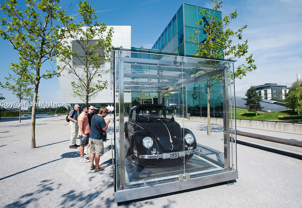 Old Volkswagen Beetle in glass display case at the Autostadt or Car City in Wolfsburg Germany