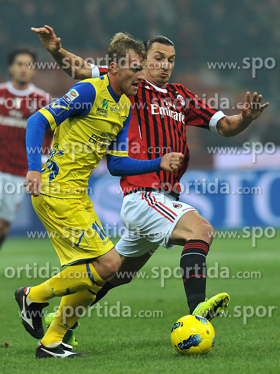 27.11.2011, Stadion Giuseppe Meazza, Mailand, ITA, Serie A, AC Mailand vs AC Chievo Verona, 13. Spieltag, im Bild Zlatan IBRAHIMOVIC (Milan), Luca RIGONI (Chievo Verona) // during the football match of Italian 'Serie A' league, 13th round, between AC Mailand and AC Chievo Verona at Stadium Giuseppe Meazza, Milan, Italy on 2011/11/27. EXPA Pictures © 2011, PhotoCredit: EXPA/ Insidefoto/ Alessandro Sabattini..***** ATTENTION - for AUT, SLO, CRO, SRB, SUI and SWE only *****