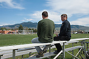 Diren Dede's soccer coach, Jay Bostrom (right), and his history teacher Cameron Johnson (left) of Big Sky High School in Missoula, Montana, talking about the weeks events at the soccer field where Dede, a 17-year-old German exchange student who was shot and killed by a neighbor, played.