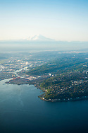Aerial view of the Seattle harbor with Mt Rainier in the background.