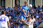 Peterborough United midfielder Mark O'Hara (8) wins this header during the EFL Sky Bet League 1 match between Peterborough United and Luton Town at London Road, Peterborough, England on 18 August 2018.