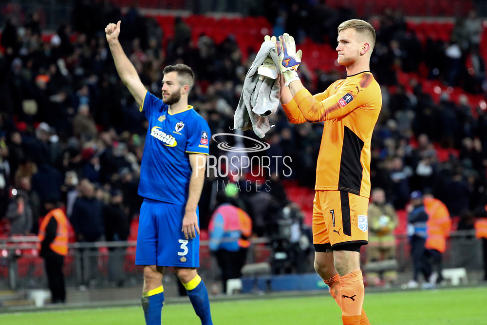 AFC Wimbledon goalkeeper George Long (1) and AFC Wimbledon defender Jon Meades (3) applauding fans during the The FA Cup 3rd round match between Tottenham Hotspur and AFC Wimbledon at Wembley Stadium, London, England on 7 January 2018. Photo by Matthew Redman.