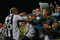 Photo: Andrew Unwin.<br /> Newcastle United v Fenerbahce. UEFA Cup. 19/10/2006.<br /> Newcastle's Antoine Sibierski (#20) celebrates his goal with the fans.
