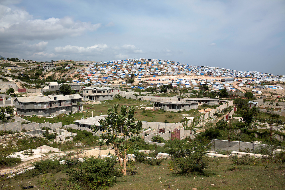 July 2010 - Massive tent cities are located above neighborhoods still under construction in an area just outside of Port-au-Prince, Haiti. More than one million people were displaced from the magnitude-7.0 earthquake that struck Haiti in January 2010.