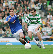 Aiden McGeady takes on Barry Ferguson during the League Cup final between Rangers and Celtic at Hampden Park -<br /> David Young Universal News And Sport