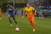 Wycombe Wanderers midfielder Garry Thompson  goes past Halifax Town defender, on loan from Lincoln City, Nat Brown  during the The FA Cup match between FC Halifax Town and Wycombe Wanderers at the Shay, Halifax, United Kingdom on 8 November 2015. Photo by Simon Davies.