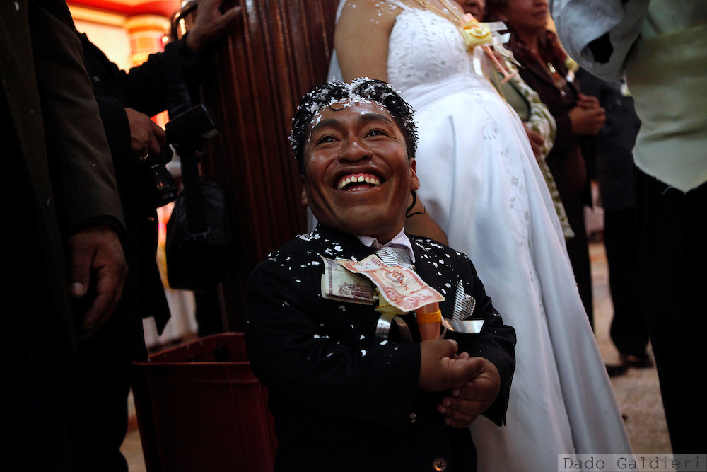 Crescencio Choque, center, smiles to guests as he celebrates his marriage in La Paz, Saturday, Dec. 19, 2009.