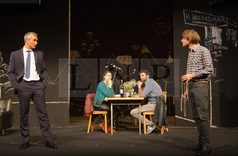 """© Licensed to London News Pictures. 24/09/2014. London, England. L-R: Ingo Hülsmann as Member of the City Council, Eva Meckbach as Mrs Stockmann, Renato Schuch  as Hovstad and Christoph Gawenda as Dr. Stockmann. German theatre company Schaubühne Berlin present an adaptation of """"An Enemy of the People"""" by Henrik Ibsen at the Barbican Theatre, Barbican Centre, from 24-28 September 2014. The play is directed by Thomas Ostermeier and part of the International Ibsen Season. Photo credit: Bettina Strenske/LNP"""