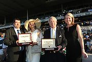 Tonalist owner Robert Evans, second right, and Valerie Clement, second left, wife of trainer Christophe Clement, are presented Longines timepieces by Jennifer Judkins, right, and Sebastien Zbinden, left, both of Longines, after Tonalist won the146th Belmont Stakes, Saturday, June 7, 2014, at Belmont Park in New York.  Longines, the Swiss watchmaker known for its elegant timepieces, is the Official Watch and Timekeeper of the 146th running of the Belmont Stakes. (Photo by Diane Bondareff/Invision for Longines/AP Images)
