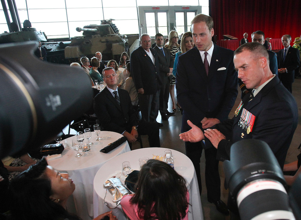 Prince William speaks to veterans and their families during a tour of the War Museum in Ottawa, Canada, July 2, 2011, on the third day of their nine day tour of Canada.<br /> AFP PHOTO/GEOFF ROBINS