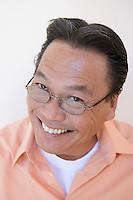 Studio portrait of man smiling