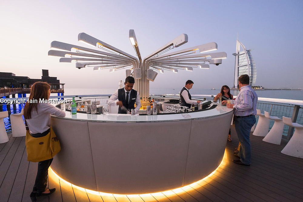 Outdoor bar on pier  in evening at Pierchic restaurant at Al Qasr Hotel Dubai United Arab Emirates