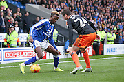 Chesterfield midfielder Gboly Ariyibi (28)  takes on Sheffield United defender, on loan from Burnley, Danny Lafferty (24)  during the EFL Sky Bet League 1 match between Chesterfield and Sheffield Utd at the b2net stadium, Chesterfield, England on 13 November 2016. Photo by Simon Davies.