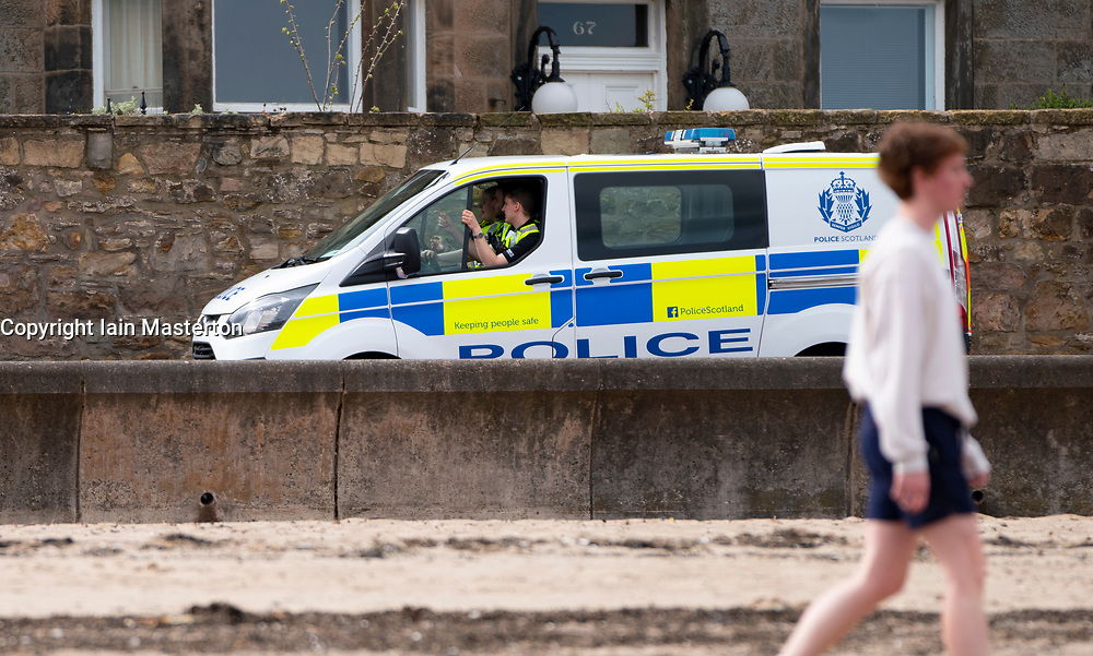 Portobello, Edinburgh. Scotland, UK. 11 April, 2020. On Easter weekend Saturday morning the public were outdoors exercising and walking on Portobello beach outside of Edinburgh. The popular beach and promenade was very quiet and people were exercising proper social distancing. Pictured; police patrol along the promenade. Iain Masterton/Alamy Live News