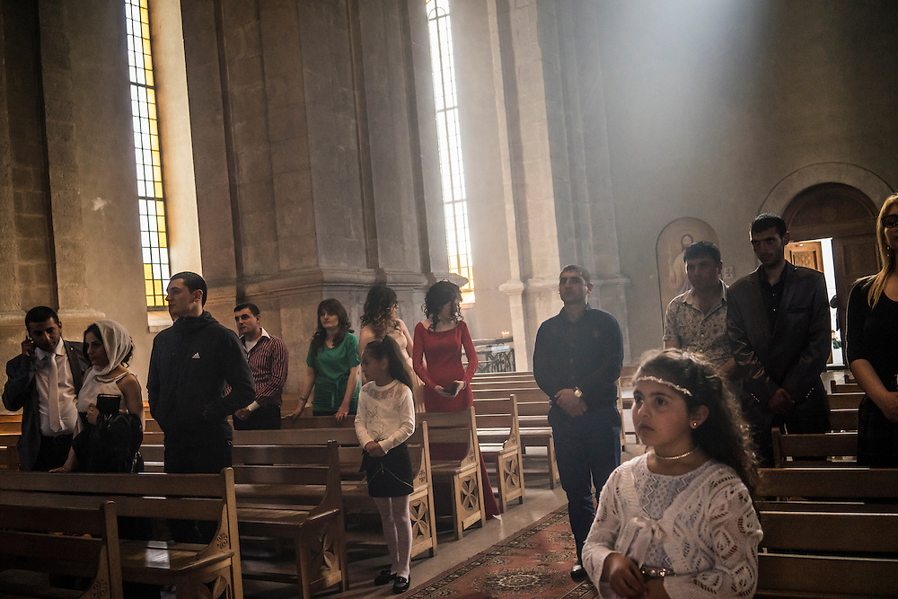 SHUSHI, NAGORNO-KARABAKH - APRIL 18: Guests attend the wedding of groom Davit Simonyan, 24, and bride Shogher Hovsepyan, 25, at Ghazanchetsots church on April 18, 2015 in Shushi, Nagorno-Karabakh. Since signing a ceasefire in a war with Azerbaijan in 1994, Nagorno-Karabakh, officially part of Azerbaijan, has functioned as a self-declared independent republic and de facto part of Armenia, with hostilities along the line of contact between Nagorno-Karabakh and Azerbaijan occasionally flaring up and causing casualties. (Photo by Brendan Hoffman/Getty Images) *** Local Caption ***