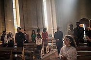 Guests attend the wedding of groom Davit Simonyan, 24, and bride Shogher Hovsepyan, 25, at Ghazanchetsots church on April 18, 2015 in Shushi, Nagorno-Karabakh. Since signing a ceasefire in a war with Azerbaijan in 1994, Nagorno-Karabakh, officially part of Azerbaijan, has functioned as a self-declared independent republic and de facto part of Armenia, with hostilities along the line of contact between Nagorno-Karabakh and Azerbaijan occasionally flaring up and causing casualties.