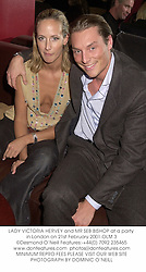 LADY VICTORIA HERVEY and MR SEB BISHOP at a party in London on 21st February 2001.OLM 3
