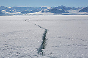 Lallemand Fjord, Antarctic Peninsula, Antarctica - A crack in the fast ice covering Lallemand Fjord show a large section of ice breaking away. <br />  &copy;Ann Inger Johansson/zReportage/Exclusivexpix media