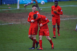 ASHTON-UNDER-LYNE, ENGLAND - Sunday, February 12, 2017: Liverpool's Ben Woodburn celebrates scoring the sixth goal against Huddersfield Town with team-mate Sam Hart during the FA Premier League Cup Group G match at Tameside Stadium. (Pic by David Rawcliffe/Propaganda)